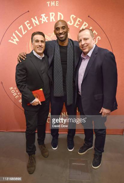 Frank Isola Kobe Bryant and Tom Thibodeau poses for a photo during the launch of the Granity Studios' debut book The Wizenard Series Training Camp to...