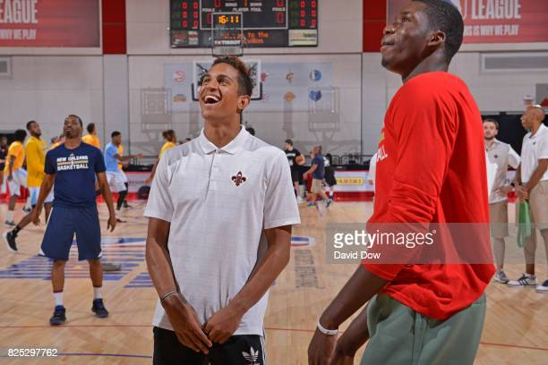 Frank Jackson and Cheik Diallo of the New Orleans Pelicans smile and look on during the 2017 Summer League game against the Denver Nuggets on July 14...