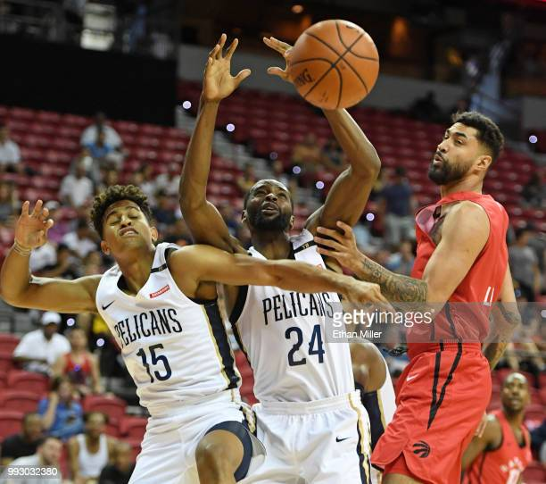 Frank Jackson and Marvin Jones of the New Orleans Pelicans and Augusto Lima of the Toronto Raptors fight for a rebound during the 2018 NBA Summer...