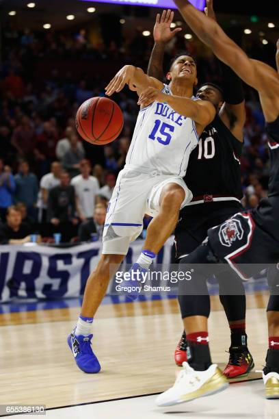 Frank Jackson of the Duke Blue Devils drives against Duane Notice and PJ Dozier of the South Carolina Gamecocks in the second half during the second...