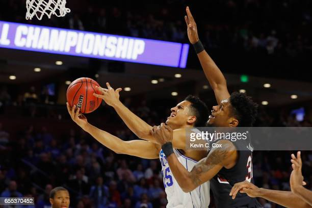 Frank Jackson of the Duke Blue Devils drives to the basket against Chris Silva of the South Carolina Gamecocks in the first half during the second...