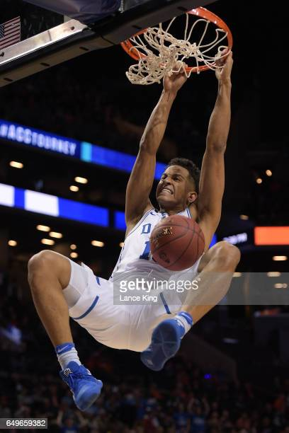 Frank Jackson of the Duke Blue Devils reacts after a dunk against the Clemson Tigers during the second round of the ACC Basketball Tournament at...