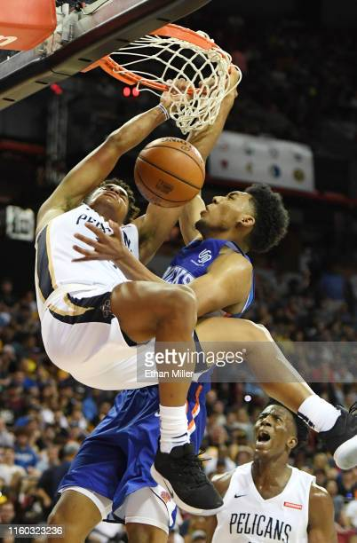 Frank Jackson of the New Orleans Pelicans dunks against Allonzo Trier of the New York Knicks during the 2019 NBA Summer League at the Thomas Mack...