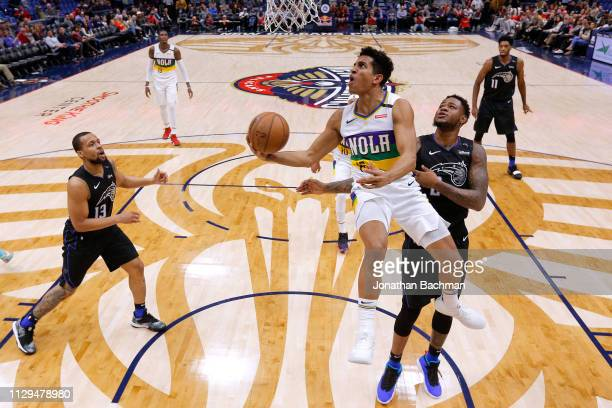 Frank Jackson of the New Orleans Pelicans shoots against Jarell Martin of the Orlando Magic during a game at the Smoothie King Center on February 12...