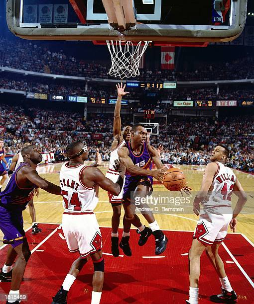 Frank Johnson of the Phoenix Suns makes a pass against the Chicago Bulls during Game Five of the 1993 NBA Championship Finals at Chicago Stadium on...