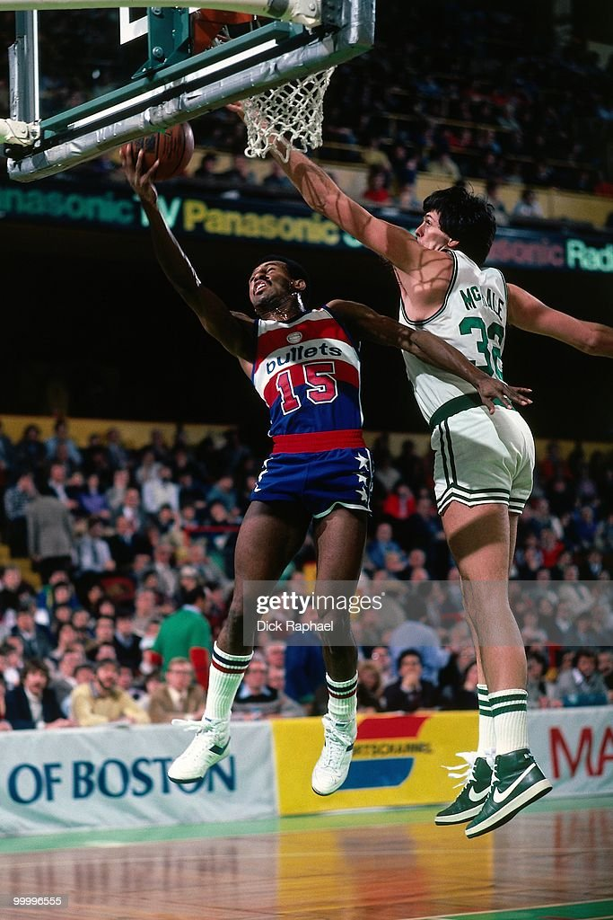Frank Johnson #15 of the Washington Bullets shoots a layup against Kevin McHale #32 of the Boston Celtics during a game played in 1983 at the Boston Garden in Boston, Massachusetts.