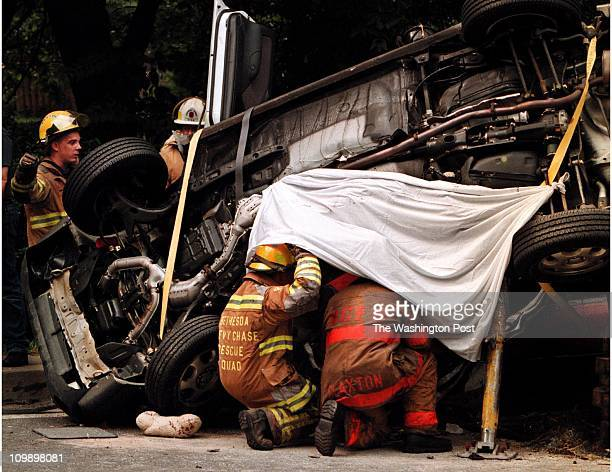 Frank JohnstonTWP EastWest Highway Maple Bethesda Md Three Vehicle accident10 injured 3 dead Bethesda Fire and Rescue team attempt to remove one of...