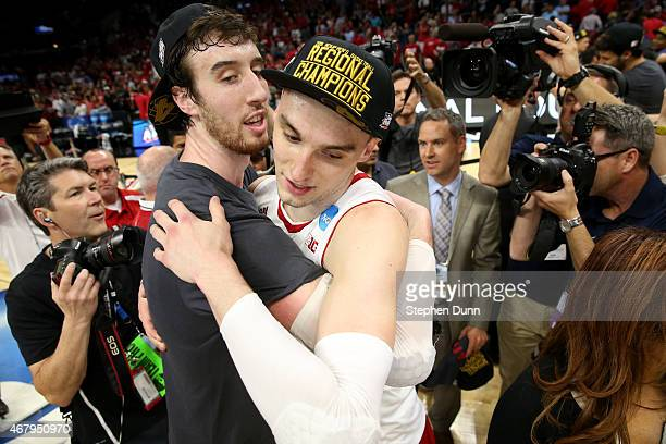 Frank Kaminsky and Sam Dekker of the Wisconsin Badgers celebrate the Badgers 8578 win against the Arizona Wildcats during the West Regional Final of...