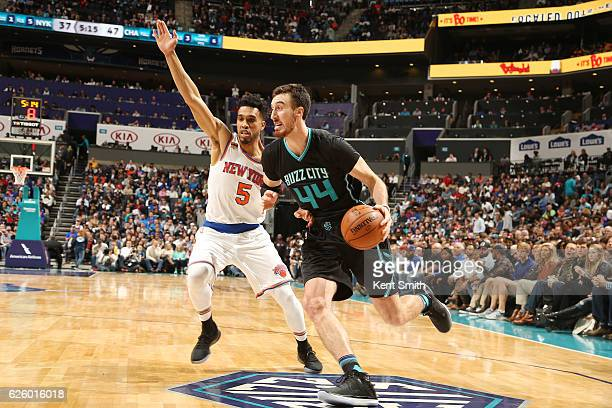 Frank Kaminsky III of the Charlotte Hornets drives to the basket against Courtney Lee of the New York Knicks during the game on November 26 2016 at...