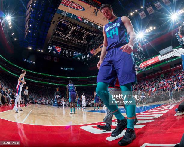 Frank Kaminsky of the Charlotte Hornets leaves the court in pain after twisting his ankle in the fourth quarter against the Detroit Pistons during...