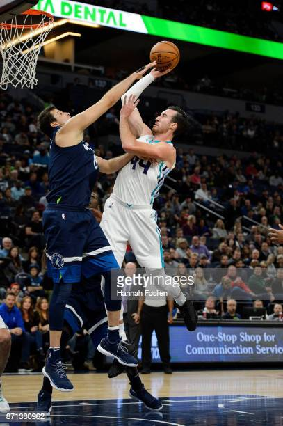 Frank Kaminsky of the Charlotte Hornets shoots the ball against Nemanja Bjelica of the Minnesota Timberwolves during the game on November 5 2017 at...