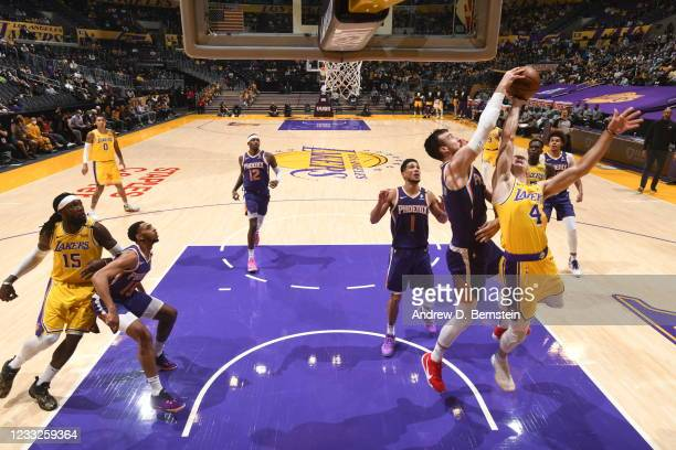 Frank Kaminsky of the Phoenix Suns blocks the shot of Alex Caruso of the Los Angeles Lakers during Round 1, Game 6 of the 2021 NBA Playoffs on June...