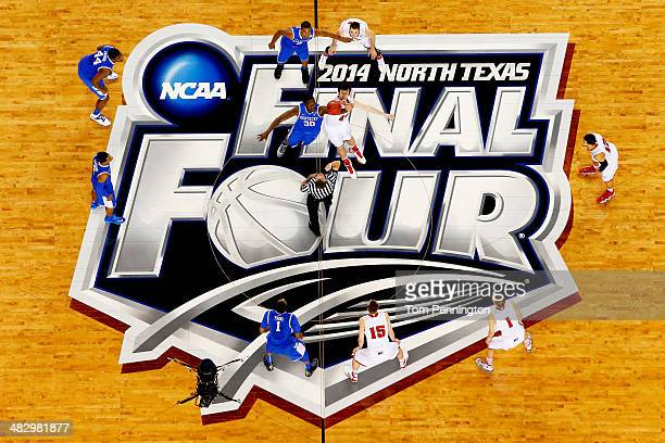 Frank Kaminsky of the Wisconsin Badgers and Julius Randle of the Kentucky Wildcats jump for the opening tip during the NCAA Men's Final Four...