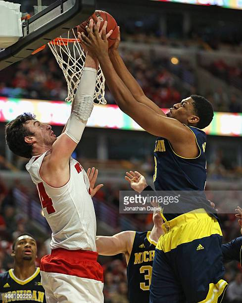 Frank Kaminsky of the Wisconsin Badgers and Kameron Chatman of the Michigan Wolverines battle for a rebound during the quarterfinal round of the 2015...