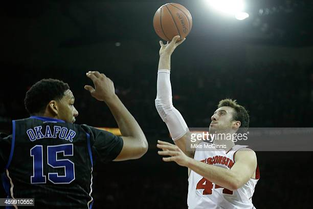 Frank Kaminsky of the Wisconsin Badgers drives to the hoop during the second half of play against the Duke Blue Devils at Kohl Center on December 03...