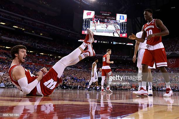 Frank Kaminsky of the Wisconsin Badgers reacts with Nigel Hayes after a play in the first half against the Duke Blue Devils during the NCAA Men's...