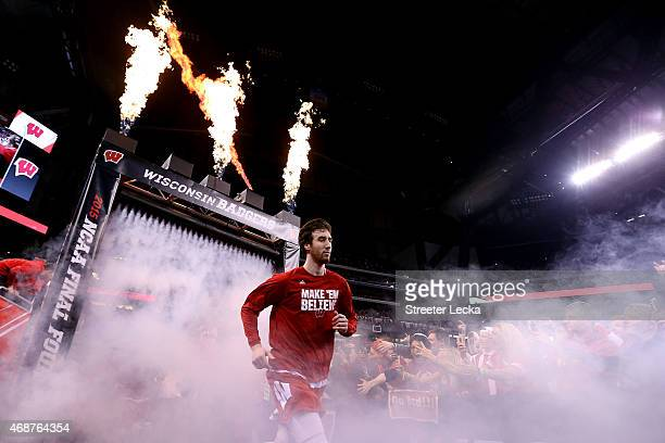 Frank Kaminsky of the Wisconsin Badgers runs out to the court before taking on the Duke Blue Devils in the NCAA Men's Final Four National...