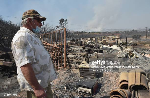 Frank Kenton looks over the remains of buildings that burnt during the Bobcat Fire last night in Juniper Hills on Saturday September 19 2020 Kenton...