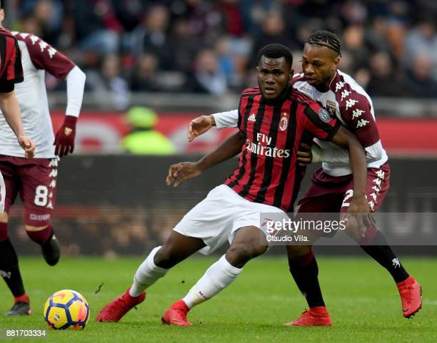 Frank Kessié of AC Milan and Joel Obi of Torino FC compete for the ball during the Serie A match between AC Milan and Torino FC at Stadio Giuseppe...