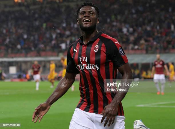 Frank Kessie of AC Milan celebrates after scoring the opening goal during the serie A match between AC Milan and AS Roma at Stadio Giuseppe Meazza on...