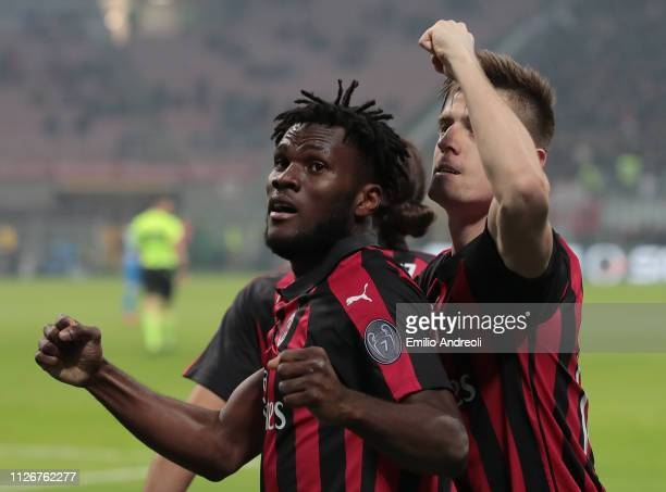 Frank Kessie of AC Milan celebrates his goal with his teammate Krzysztof Piatek during the Serie A match between AC Milan and Empoli at Stadio...