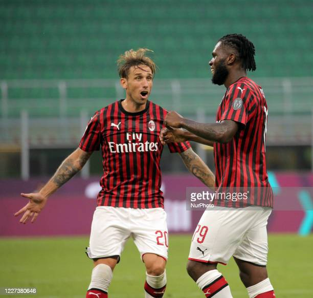 Frank Kessie of AC Milan celebrates with Lucas Biglia of AC Milan after scoring the goal during the Serie A match between AC Milan and Parma Calcio...
