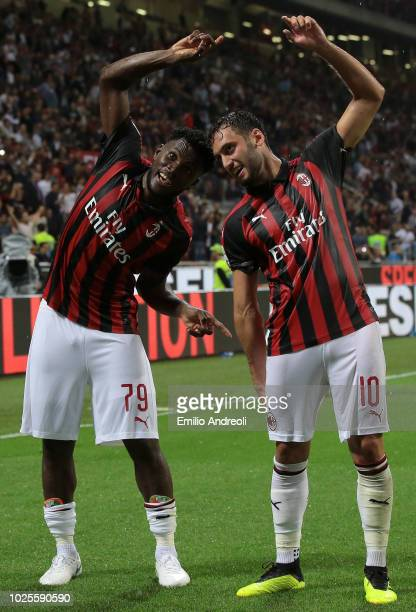 Frank Kessie of AC Milan celebrates with teammate Hakan Calhanoglu after scoring the opening goal during the serie A match between AC Milan and AS...