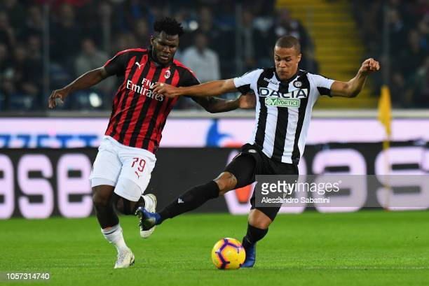 Frank Kessie of AC Milan competes for the ball with William Ekong of Udinese Calcio during the Serie A match between Udinese and AC Milan at Stadio...