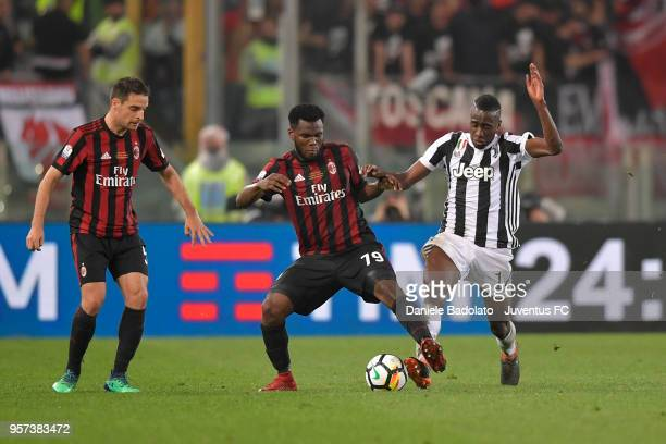 Frank Kessie of Milan and Blaise Matuidi of Juventus in action during the TIM Cup Final between Juventus and AC Milan at Stadio Olimpico on May 9...