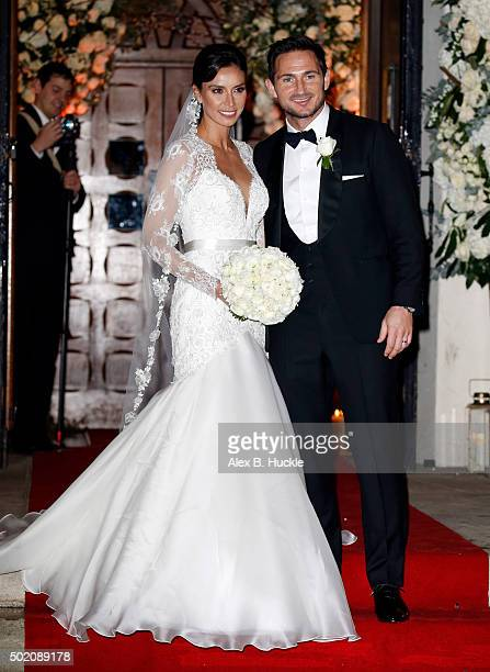 Frank Lampard and Christine Bleakley pose for pictures as they leave St Paul's Church after their wedding on December 20 2015 in London England