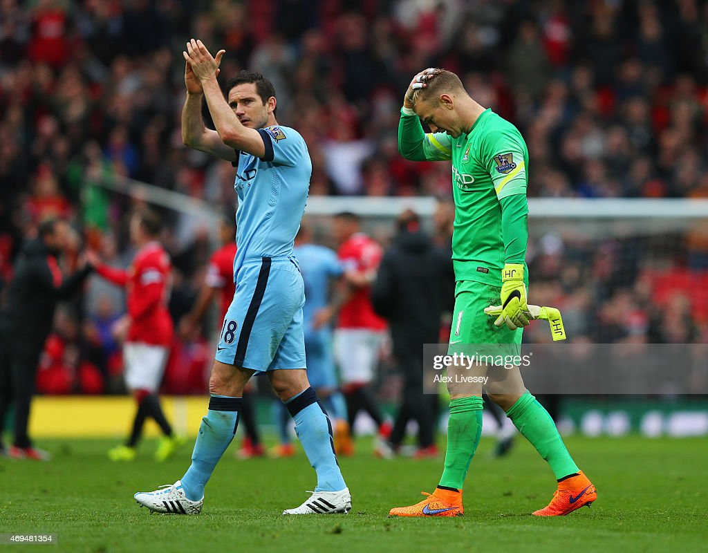 Frank Lampard and Joe Hart of Manchester City look dejected in defeat after the Barclays Premier League match between Manchester United and Manchester City at Old Trafford on April 12, 2015 in Manchester, England.