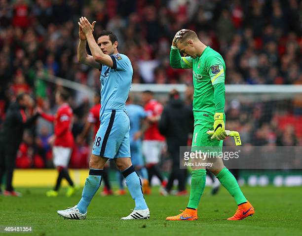 Frank Lampard and Joe Hart of Manchester City look dejected in defeat after the Barclays Premier League match between Manchester United and...