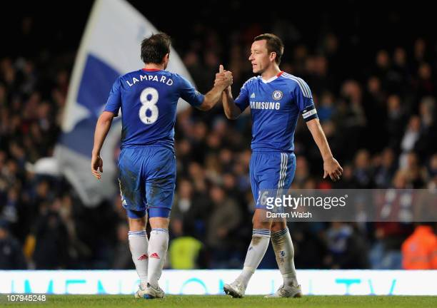 Frank Lampard and John Terry of Chelsea celebrate a 70 victory after the FA Cup sponsored by EON 3rd Round match between Chelsea and Ipswich Town at...