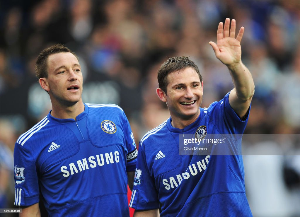 Frank Lampard and John Terry of Chelsea look on as they win the title after the Barclays Premier League match between Chelsea and Wigan Athletic at Stamford Bridge on May 9, 2010 in London, England. Chelsea won 8-0 to win the championship.