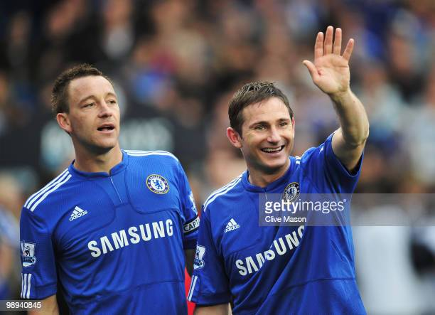 Frank Lampard and John Terry of Chelsea look on as they win the title after the Barclays Premier League match between Chelsea and Wigan Athletic at...