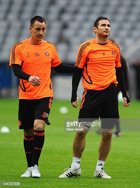 Frank Lampard and John Terry of Chelsea look on during the Chelsea training session ahead of the UEFA Champions League Final between FC Bayern...