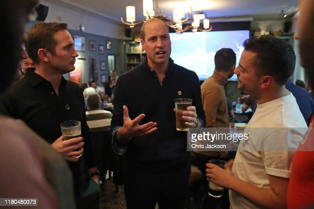 Frank Lampard and Prince William Duke of Cambridge join football fans who have been supported by mental health charities Mind and CALM to watch the...