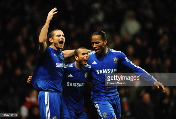 Frank Lampard Ashley Cole and Didier Drogba ofChelsea celebrate Drogba's goal l during the Barclays Premier League match between Arsenal and Chelsea...