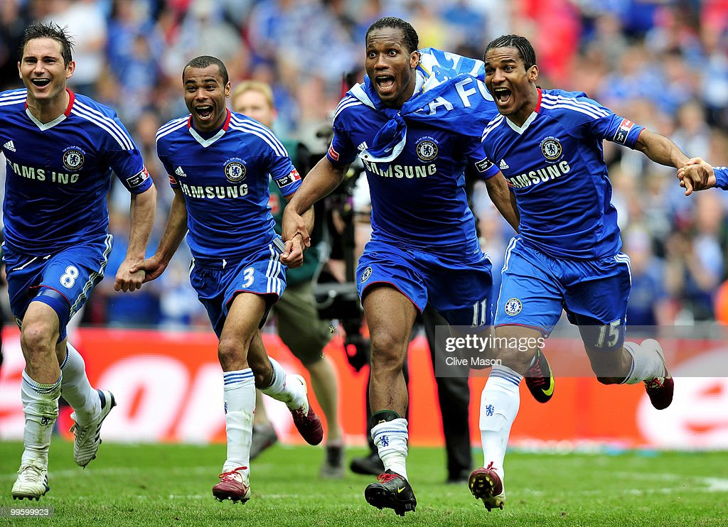 Frank Lampard (L), Ashley Cole, Didier Drogba and Florent Malouda of Chelsea celebrate at the end of the FA Cup sponsored by E.ON Final match between Chelsea and Portsmouth at Wembley Stadium on May 15, 2010 in London, England.