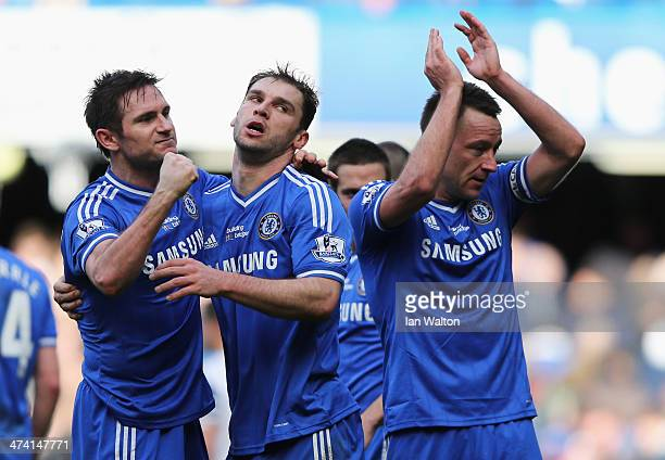 Frank Lampard Branislav Ivanovic and John Terry of Chelsea celebrate victory after the Barclays Premier League match between Chelsea and Everton at...