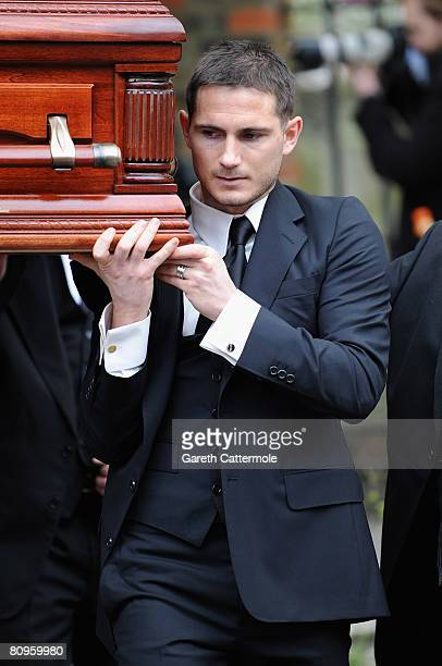 Frank Lampard carries the coffin of his mother Pat after her funeral at St Margarets Church on May 2 2008 in Barking England