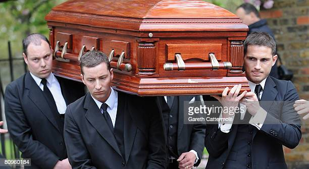 Frank Lampard carries the coffin of his mother Pat after her funeral at St Margaret's Church on May 2 2008 in Barking England