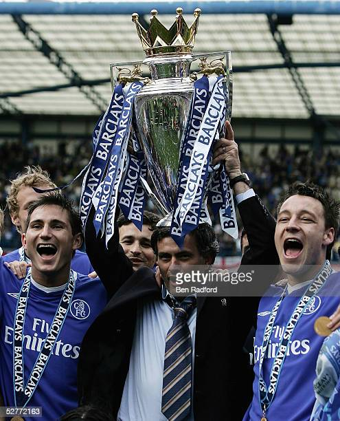 Frank Lampard Jose Mourinho and John Terry hold the trophy up as his Chelsea team mates celebrate after receiving the Barclays Premiership Trophy at...