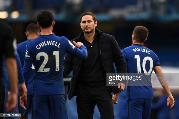 Frank Lampard Manager of Chelsea and Ben Chilwell of Chelsea celebrate following their team's victory in the Premier League match between Chelsea and...