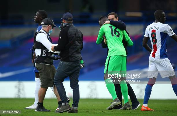 Frank Lampard Manager of Chelsea and Edouard Mendy of Chelsea celebrate following their team's victory in the Premier League match between Chelsea...