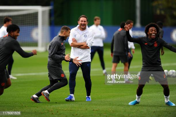 Frank Lampard Manager of Chelsea and Mateo Kovacic of Chelsea react during the Chelsea FC training session on the eve of the UEFA Champions League...