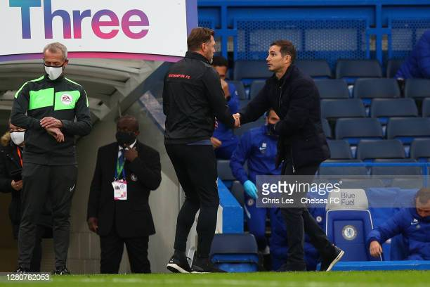 Frank Lampard Manager of Chelsea and Ralph Hasenhuttle Manager of Southampton interact after the Premier League match between Chelsea and Southampton...