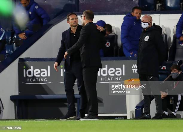 Frank Lampard Manager of Chelsea and Slaven Bilic Manager of West Bromwich Albion react at full time of the Premier League match between West...