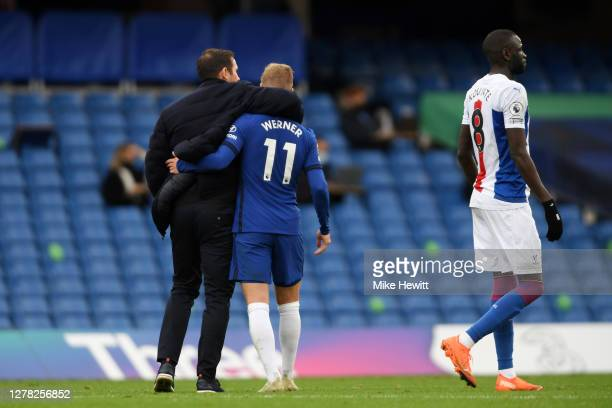 Frank Lampard Manager of Chelsea and Timo Werner of Chelsea celebrate following their team's victory in the Premier League match between Chelsea and...