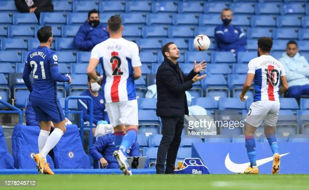 Frank Lampard Manager of Chelsea catches the ball during the Premier League match between Chelsea and Crystal Palace at Stamford Bridge on October 03...